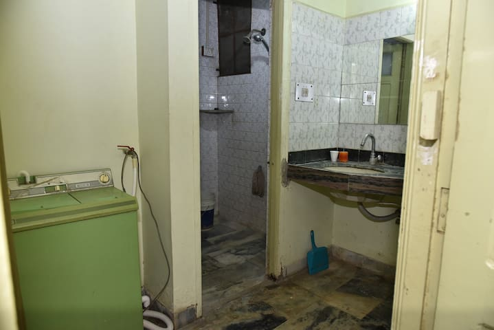 Bathroom #2 is next to the wash basin, There is also a washing machine w/Dryer where you can do your laundry. [Washing Powder is provided]