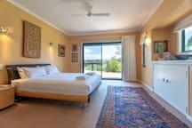 Master bedroom with sliding doors to outdoor deck area.