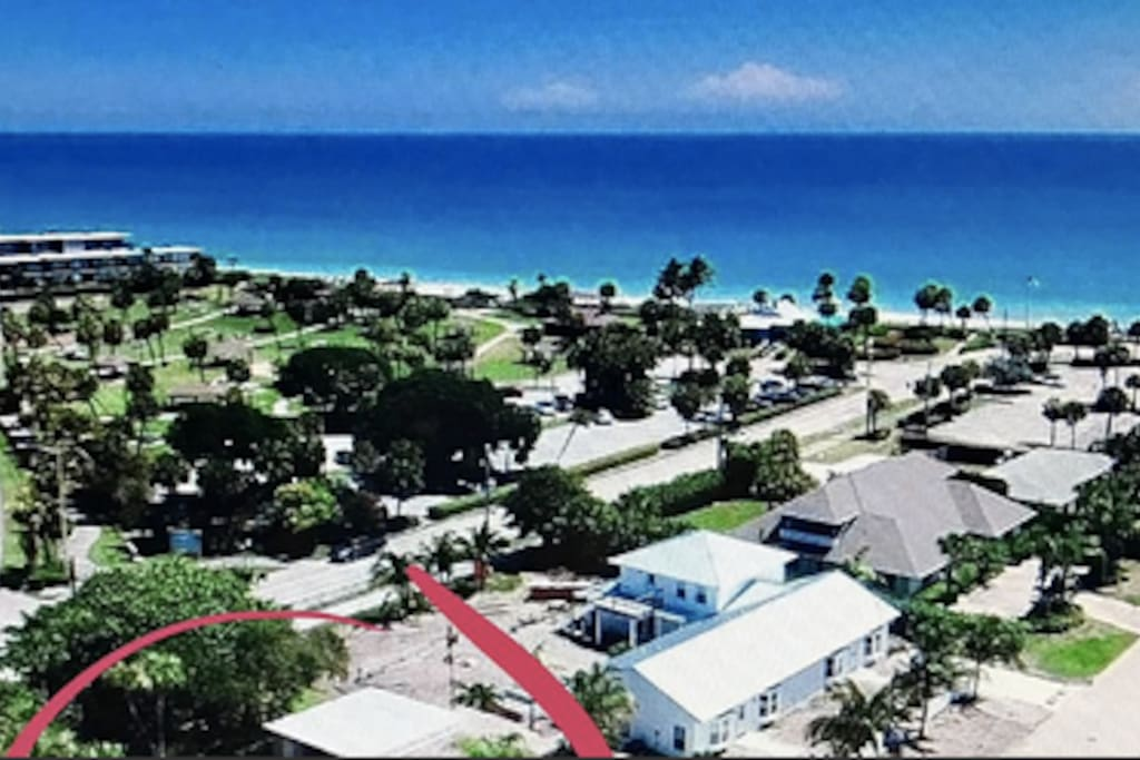 Aerial photo from above property showing proximity to beach and park.