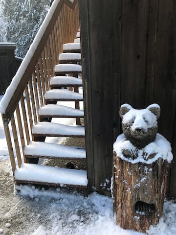 Park by the  bear and the stairs to your hide-away