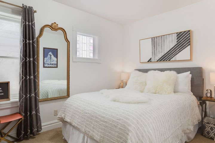 First bedroom with a queen sized bed.     Photo Verified by Airbnb
