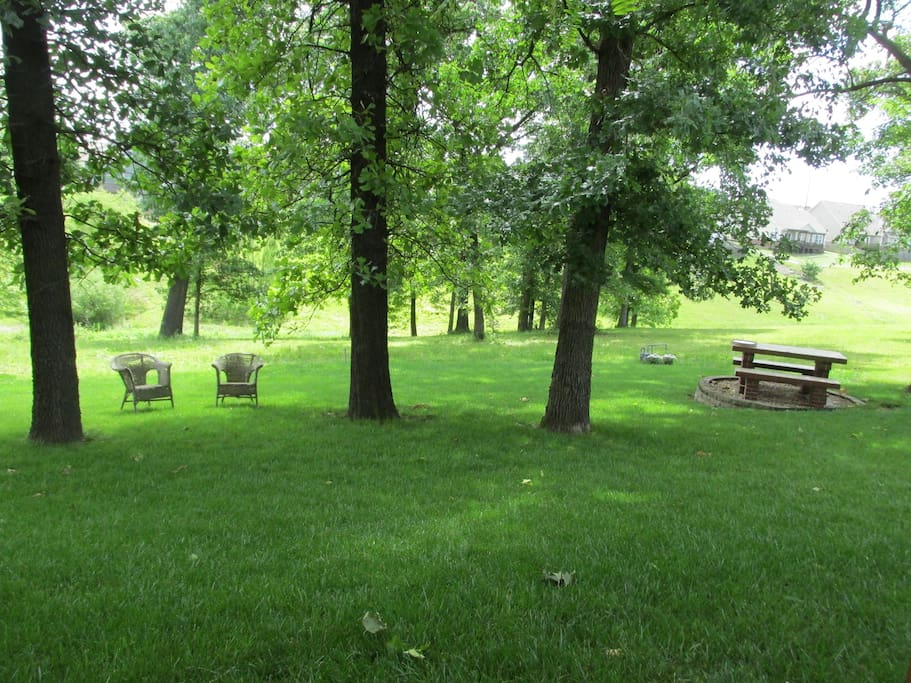 Guests have access to a shady yard with a patio, picnic table and fire pit.