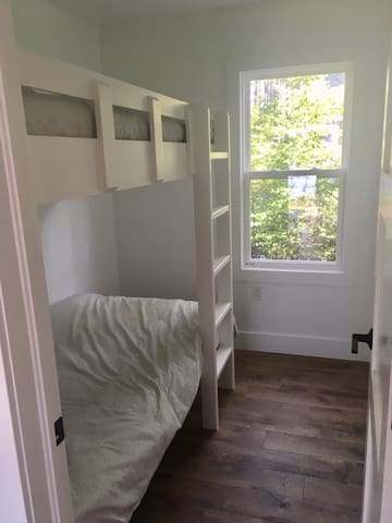 Bunk room with two single beds