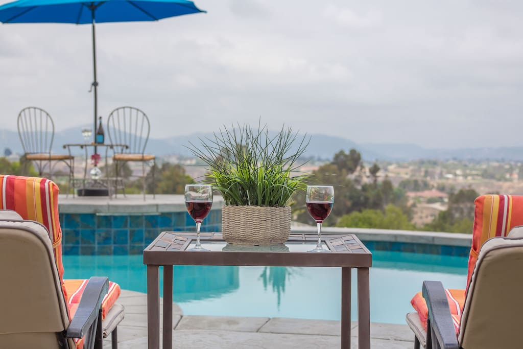 Elegant Seating Areas Overlooking Pool, Winery and Mountain Views