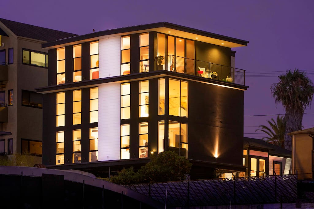 Exterior of the building at night.  Penthouse occupies entire top floor of the building.