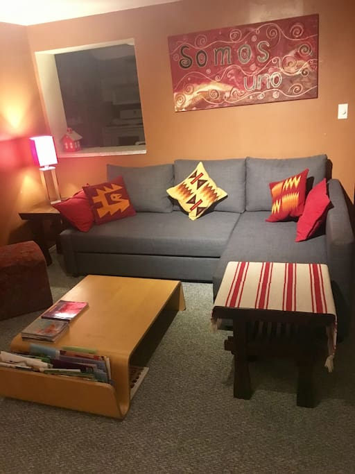 Living room sofa easily becomes an extra full size bed