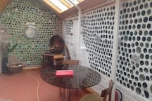 The 'dining area' for eating, playing cards/board games. Guests have an outside BBQ area for disposable BBQ's.  The porthole window opens - a fun way to pass things inside and out. (or you can always call out and have a takeaway delivered)