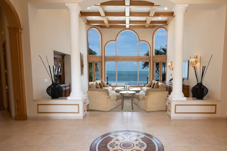 Exclusive beachfront villa hosting up to 14 guests
