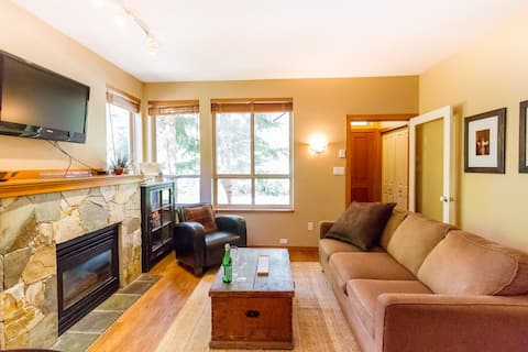 Open living space with cozy gas fireplace. This is the couch with the sofabed.
