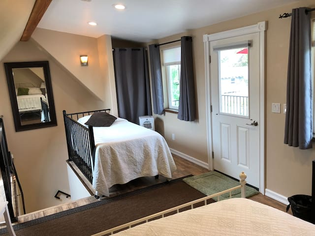 Twin Size Bed  Washer and dryer behind curtains