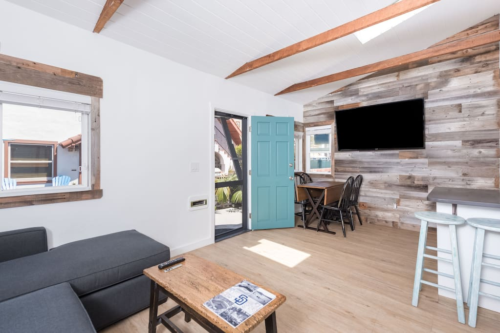 Newly remodeled, light and bright interior. Minimalist decor utilizing reclaimed wood, vaulted ceilings, exposed original beams and large internet capable  TV