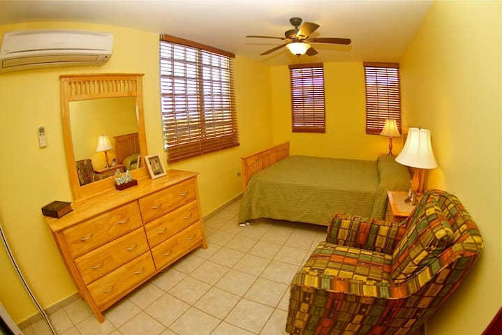 Queen Bed with Air Conditioning