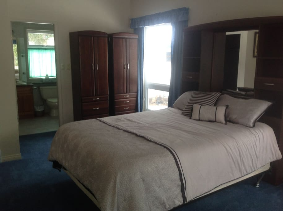 Bedroom 4 on the main level, full bathroom with tub/shower, walk in closet and private patio door to your own deck area.