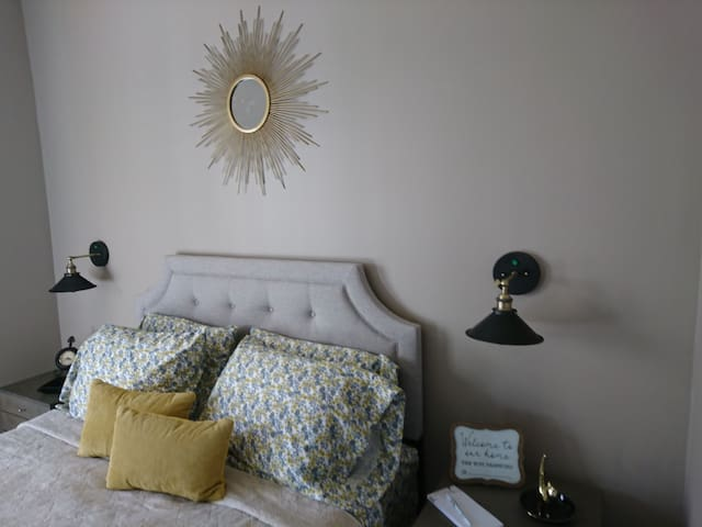 The bedroom has a Sunburst mirror over headboard. The mattress is queen size memory foam.