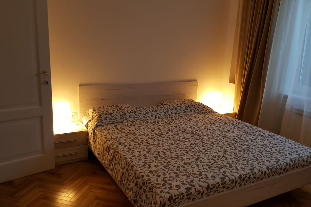 Room 1 with 2 person bed and private dressing area