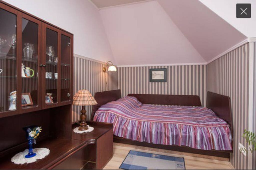 The bedroom with a doublebed and a singlebed