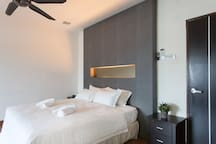Upstairs Master Bedroom: Clean, white alluring sheets are prepared for all guests.