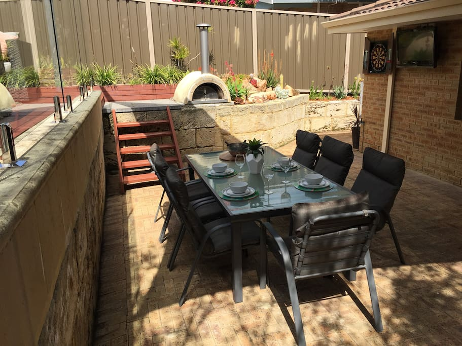 Garden dining area with pizza oven