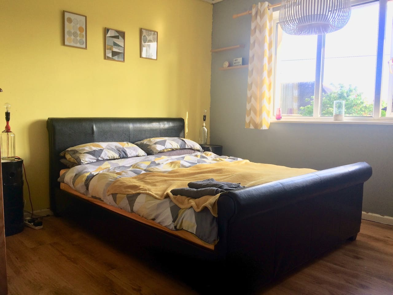 Double bedroom, with TV, king sized bed, built in wardrobe, chest of drawers & 2 bedside units.
