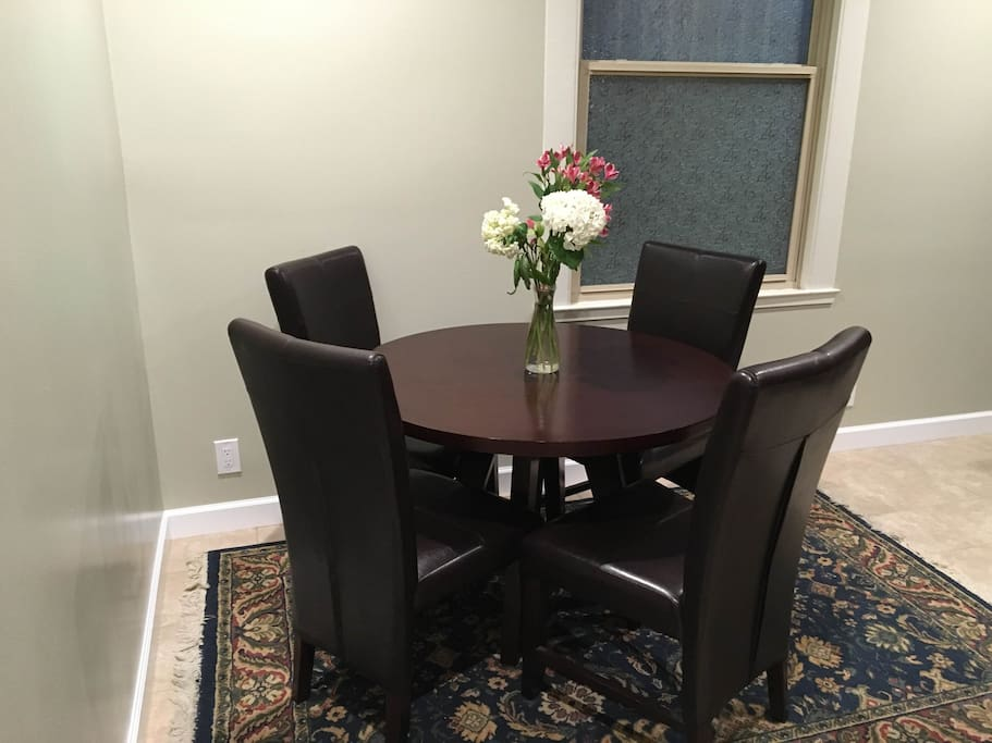Dining table with comfortable leather chairs