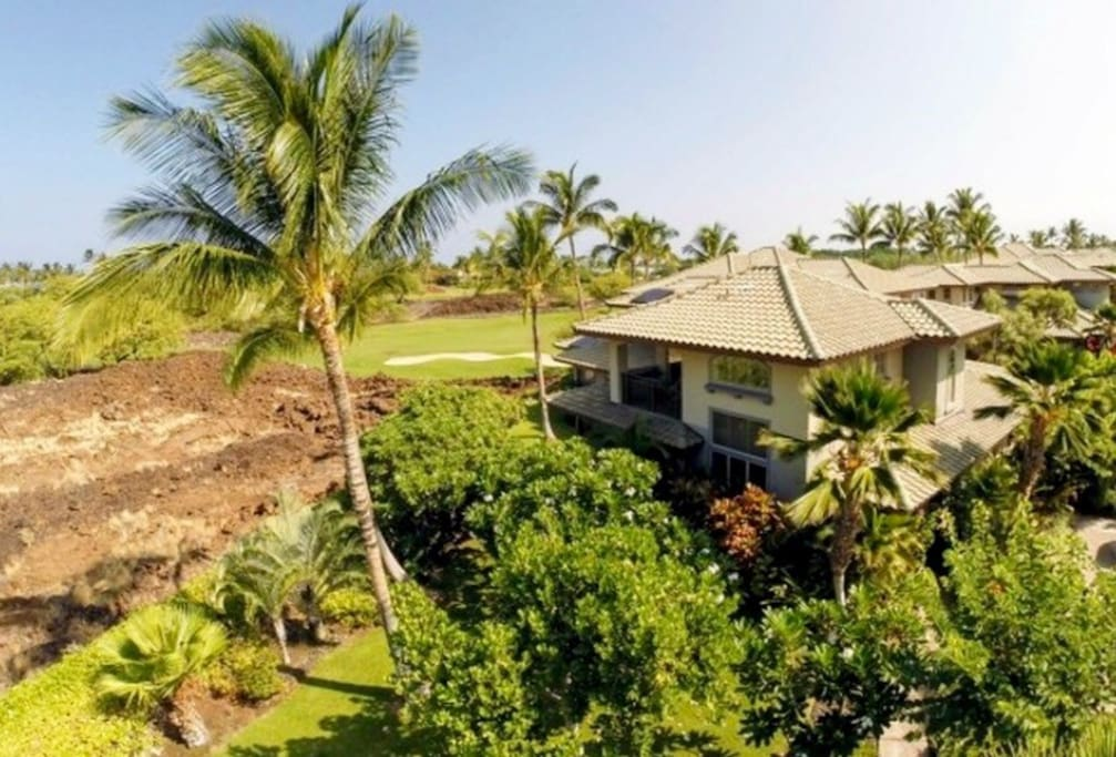 Very private end unit with views over lava field and North Golf Course designed by Francis H. Brown.