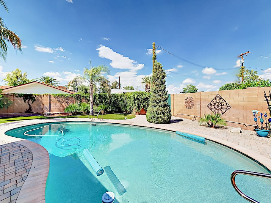 The private swimming pool awaits in the backyard.