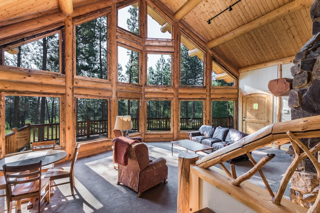 Spacious family area with cathedral ceilings and floor to ceiling windows
