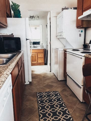 Galley style kitchen,  dishwasher, washer/dryer. The one bathroom has tub and shower.