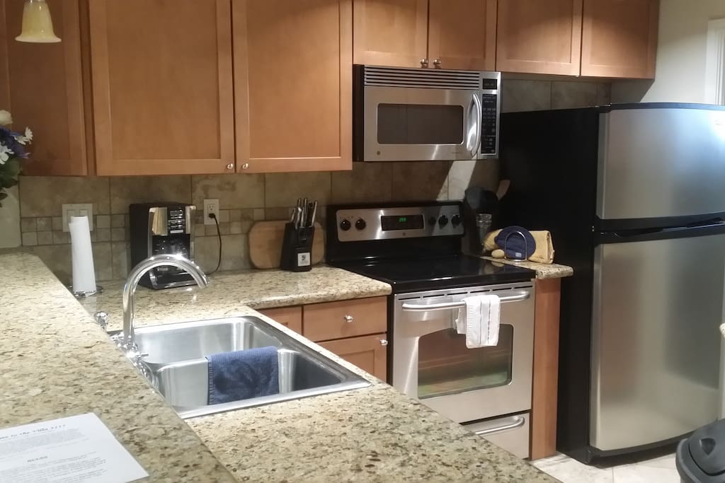 Full kitchen with pots , pans, toaster , microwave, blender, plates, cutlery, block knives, dishwasher, disposal, coffee maker, ice maker fridge -freezer, and more.