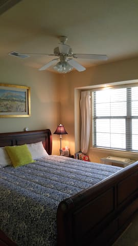 + Guestroom with king-size bed and bath.