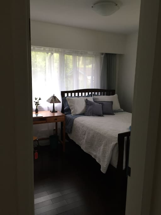 Second bedroom is bright and south facing with a double bed, desk and ample closet space.
