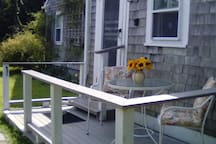 Deck entrance with outdoor dining