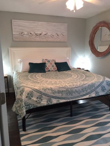 King size bed in the guest room on main level