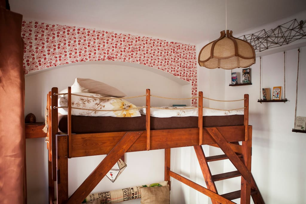 Wooden loft bed with comfortable stairs