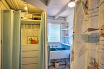 The studio has a full bathroom with extra storage space for your belongings.