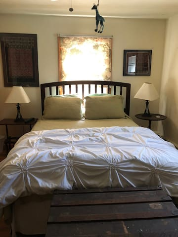 comfy pillow top queen sized bed in air conditioned room