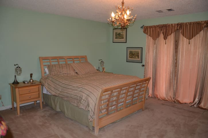 """This is the """"fantasy"""" room with a private bathroom and access to the deck."""