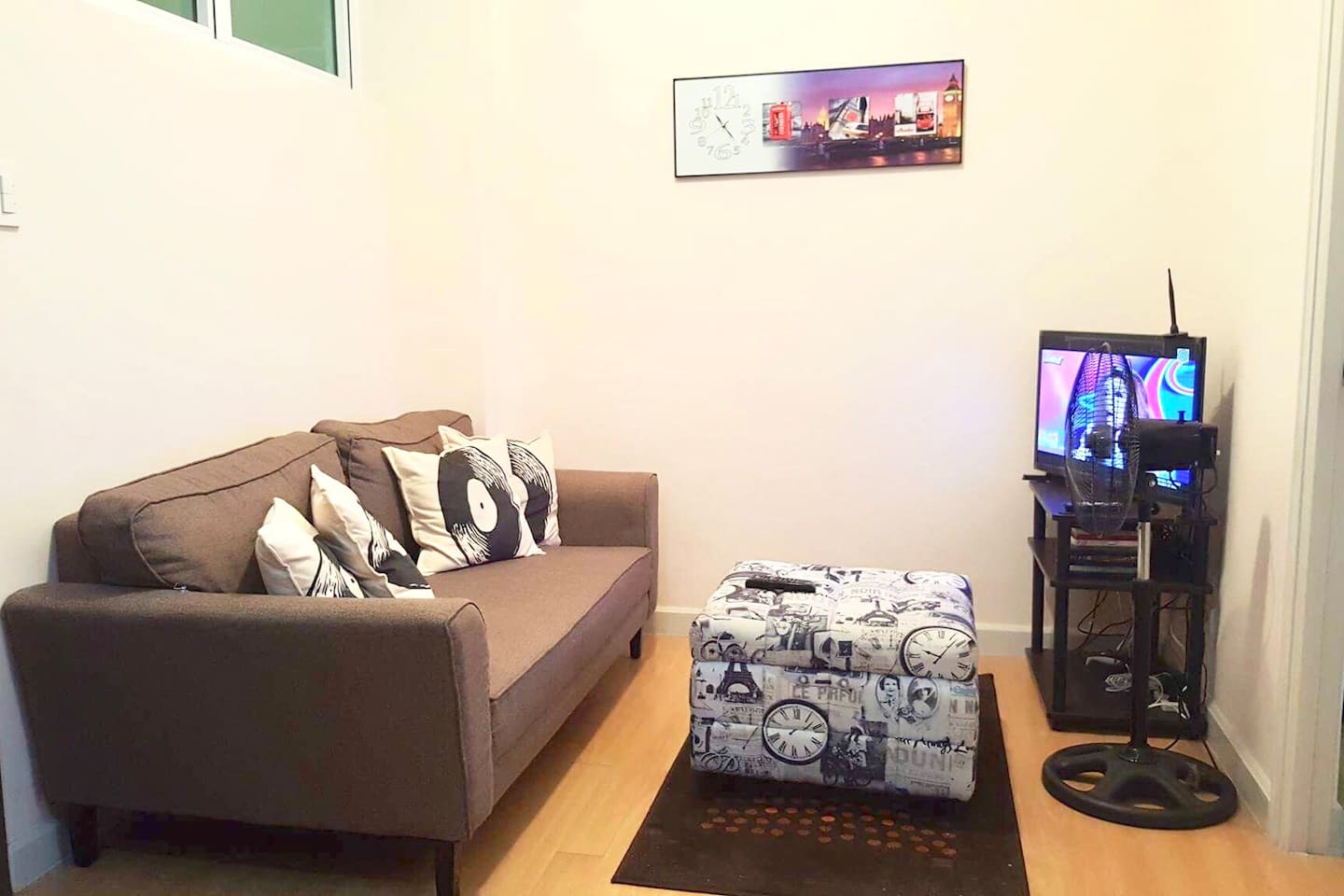 The receiving room with a settee, television and a tv box