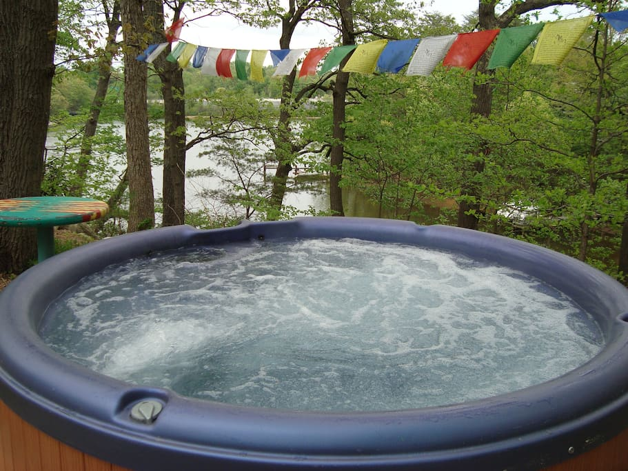 imagine relaxing in the huge outdoor hot tub overlooking the bay and bonfire pit