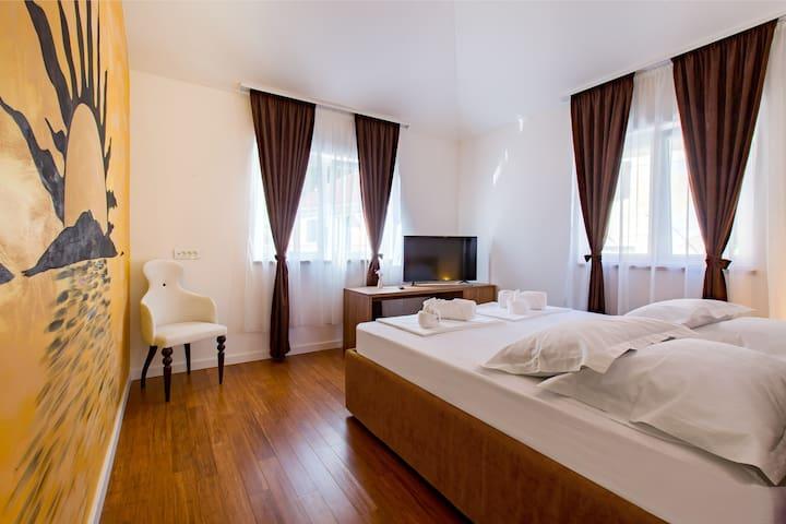 Bedroom No2 with en-suite bathroom, mini bar, flat TV, A/C, a wardrobe and a safe