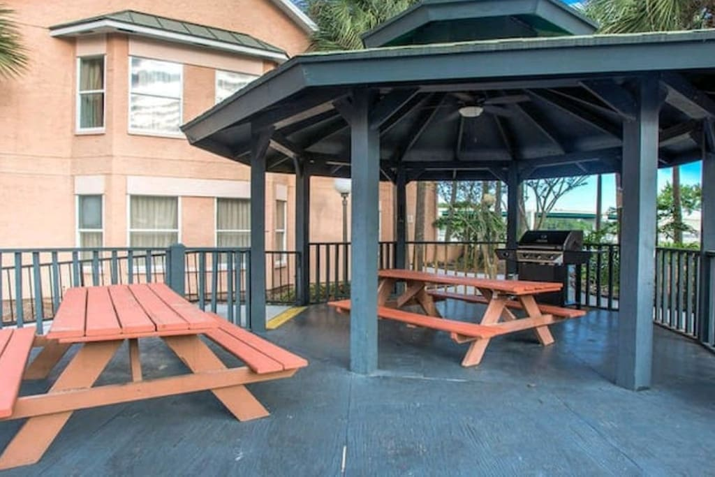 A sundeck and a gazebo area with picnic tables and gas grill (utensils available in front desk for free)