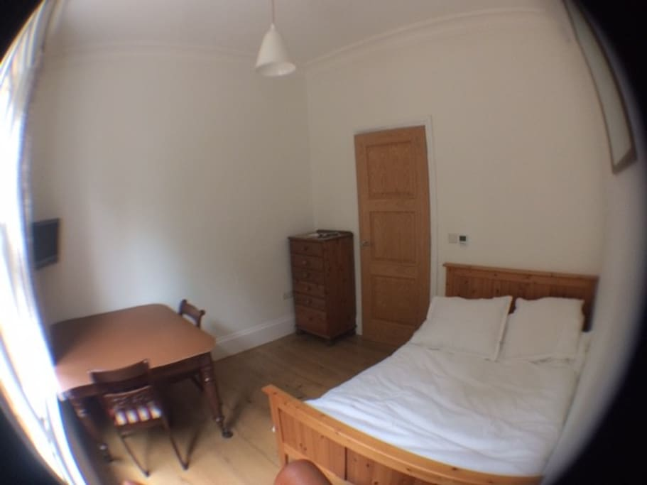 Fisheye lens view of bedroom