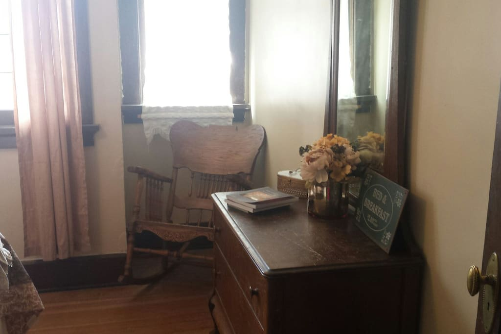 Antique rocker and dresser fit the Arts and Crafts style home.