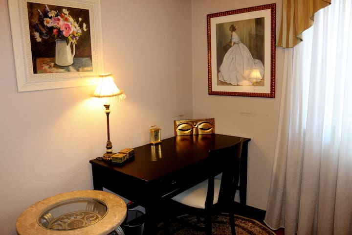 Beautiful paintings abound in the Princess room. And, another view of your comfy desk & chair as well as your marble table. (Aug 2019)