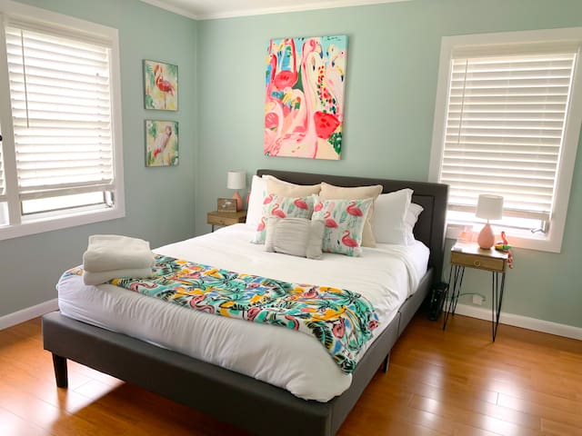 """Queen sized bed in our """"flamingo room"""" with a brand new pillow top mattress"""