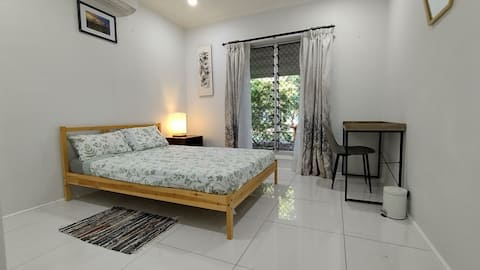 Modern bedroom in a stunning home with golf course frontage