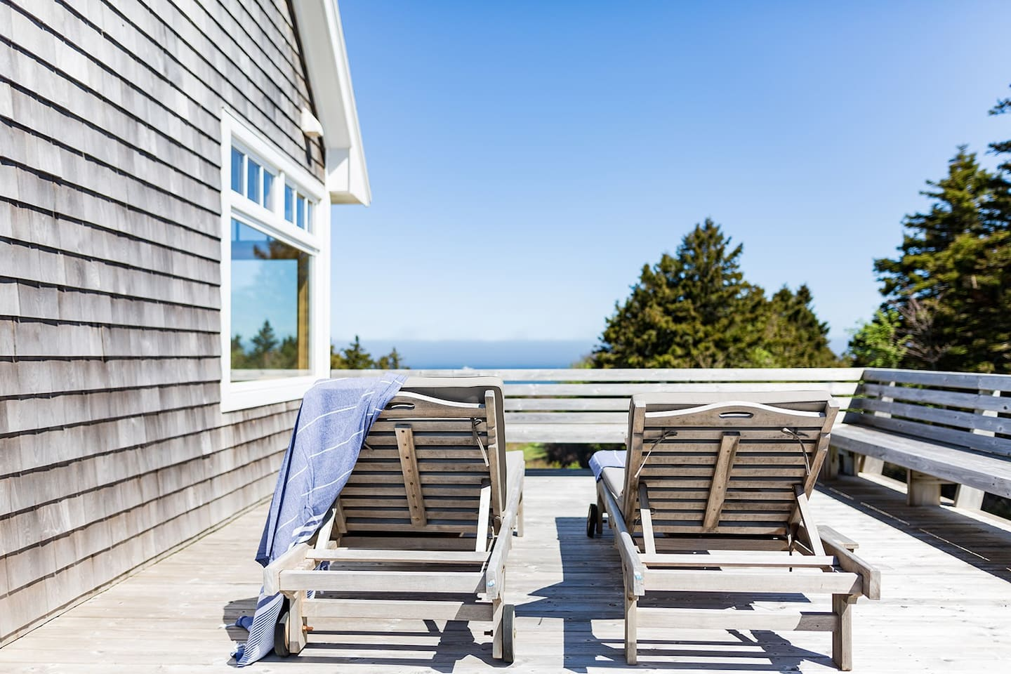 This private oceanfront home is the perfect summer getaway.  Enjoy the main house & bunky, 3 decks, outside shower, fire pit & beach gear.  Take the golf cart down the private path to your very own white sand beach.  Late check-out & early check-ins!