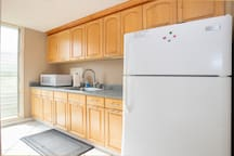 Full kitchen includes refrigerator, microwave oven, gas stove and oven, toaster, coffee maker, blender, and full array of utensils and glassware and cookware