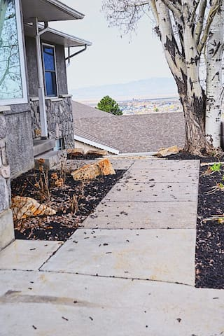 Walk past the front door to the natural, stone steps.