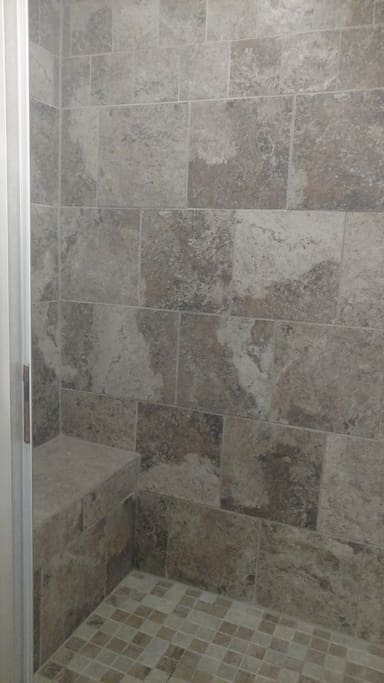 Tile walk in shower with bench seat
